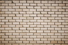 Fondo di vecchio muro di mattoni sporco d'annata con il gesso della sbucciatura, struttura immagini stock libere da diritti