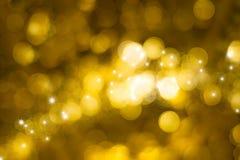 Fondo dorato astratto del bokeh delle luci Fotografie Stock Libere da Diritti