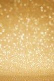 Fondo dorato dell'estratto di scintillio Immagini Stock