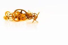 Fondo dorato dell'ingranaggio dell'orologio Fotografie Stock