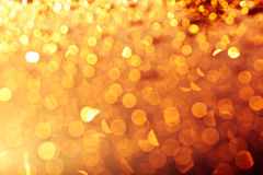 Fondo dorato delle luci di natale Fotografie Stock Libere da Diritti