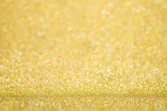 Fondo dorato di lusso del bokeh Natale magico Fotografia Stock