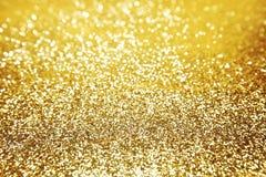 Fondo dorato di scintillio immagine stock