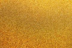 Fondo dorato di scintillio con poche scintille Fotografia Stock