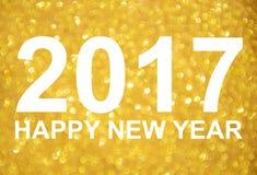 Fondo dorato di scintillio del nuovo anno 2017 Fotografia Stock Libera da Diritti