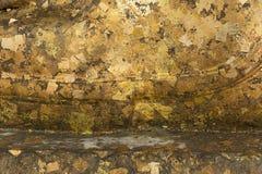 Fondo dorato posteriore di struttura di Buddha fotografie stock