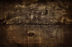 Fondo dorato rustico scuro della parete, struttura di vecchio tavolo della presidenza dorato Struttura di legno di lerciume, vist fotografie stock
