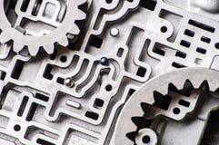 Fondo e modello di vecchie parti di metallo del contenitore di cambio trasmissioni ed ingranaggi del Idro-cervello immagine stock
