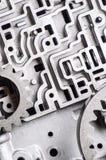 Fondo e modello di vecchie parti di metallo del contenitore di cambio trasmissioni ed ingranaggi del Idro-cervello fotografie stock libere da diritti