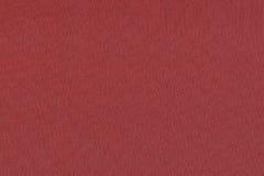 Fondo el color carmesí de la materia textil, Imagen de archivo