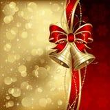 Fondo elegante de la Navidad con las alarmas de oro Fotos de archivo
