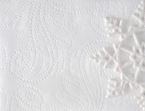Fondo elegante minimo di Natale Fiocco di neve su struttura del Libro Bianco Fotografia Stock