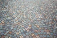 Fondo empedrado adoquín del pavimento del granito Imagen de archivo