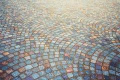 Fondo empedrado adoquín del pavimento del granito Fotografía de archivo libre de regalías