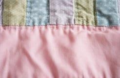 Fondo en colores pastel del edredón Fotografía de archivo