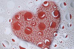 Fondo en forma de corazón de las gotas Fotografía de archivo libre de regalías