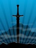 Fondo, espada en piedra Fotos de archivo libres de regalías