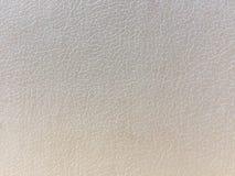 Fondo-estructura del color crema del cuero artificial fotos de archivo