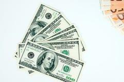 Fondo, euro e dollari dei soldi su un fondo grigio Immagini Stock Libere da Diritti