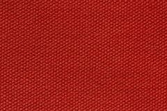 Fondo exacto del tejido en color rojo fantástico fotografía de archivo