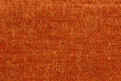 Fondo fantástico de la materia textil en color anaranjado saturado fotografía de archivo
