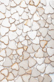 Fondo fatto dei cuori di legno Fotografie Stock
