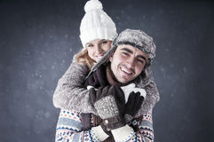 Fondo feliz de la nieve de la cubierta de los pares Fotos de archivo