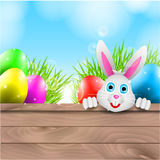 Fondo feliz de Pascua del vector con el conejito y Colo Foto de archivo