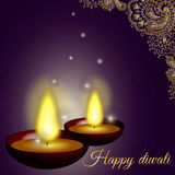 Fondo feliz del diwali con las velas, el modelo y el brillo Foto de archivo
