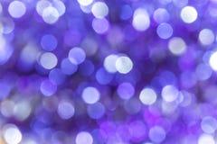 Fondo festivo astratto con il co viola del bokeh e blu porpora immagini stock