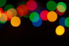 Fondo festivo con las luces coloreadas Foto de archivo libre de regalías