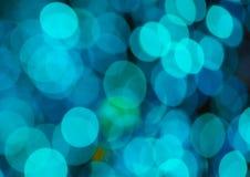 Fondo festivo con las luces del bokeh, para el diseño Foto de archivo