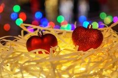 Fondo festivo de la Navidad con formas del corazón Fotografía de archivo