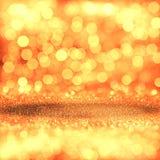 Fondo festivo de oro del brillo con las luces defocused Fotografía de archivo libre de regalías