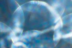 Fondo festivo metálico de las luces ámbar del oro La Navidad abstracta centelleó fondo brillante con las luces de plata defocused Fotografía de archivo
