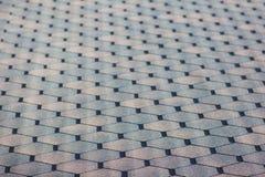Fondo geometrico strutturato grigio che svanisce profondità di campo immagine stock libera da diritti