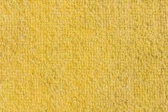 Fondo giallo approssimativo dello zerbino, struttura Immagine Stock
