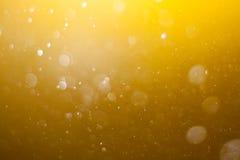 Fondo giallo astratto del bokeh Fotografia Stock