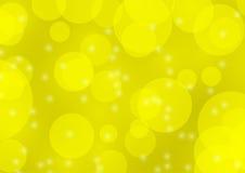 Fondo giallo astratto della sfuocatura del bokeh Immagini Stock