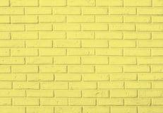 Fondo giallo del modello del muro di mattoni Fotografia Stock