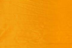 Fondo giallo del tessuto Immagine Stock