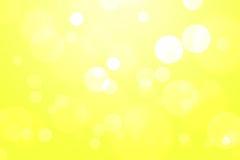 Fondo giallo dell'estratto del bokeh Immagini Stock