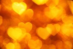 Fondo giallo di forma dei cuori Immagini Stock