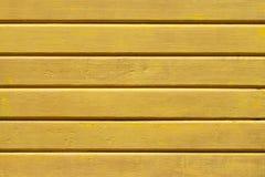 Fondo giallo di legno della pittura Fotografia Stock