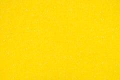 Fondo giallo di struttura del primo piano della spugna Immagini Stock Libere da Diritti
