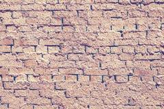 Fondo giallo ed arancio afflitto della muratura di pietra con argilla fotografia stock libera da diritti