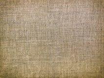 Fondo giallo-marrone d'annata del tessuto Immagini Stock