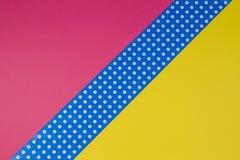 Fondo giallo, rosa e blu geometrico astratto della carta del pois Fotografie Stock