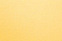 Fondo giallo strutturato Immagini Stock
