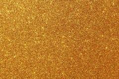Fondo Glittery de oro imágenes de archivo libres de regalías
